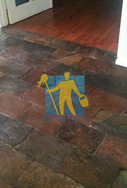 dirty and dull looking slate tiles requires stripping and sealing Canberra cleaning
